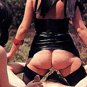 Perverted dark brown nut in dark latex copulates with a tractable boy outdoors.