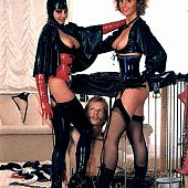 2 dominative vintage whores command their male slave.